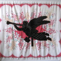 From the series American Memento Mori: Angel - applique and embroidery on vintage textile. A folk art weathervane of an angel in silhouette with a skeleton head is appliquéd onto a colorful vintage tablecloth, and embellished with white embroidery.