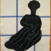 From the series American Memento Mori: Baby - applique and embroidery on vintage textile. A folk art portrait of a baby in silhouette with a skeleton head is appliquéd onto a colorful vintage tablecloth, and embellished with white embroidery.